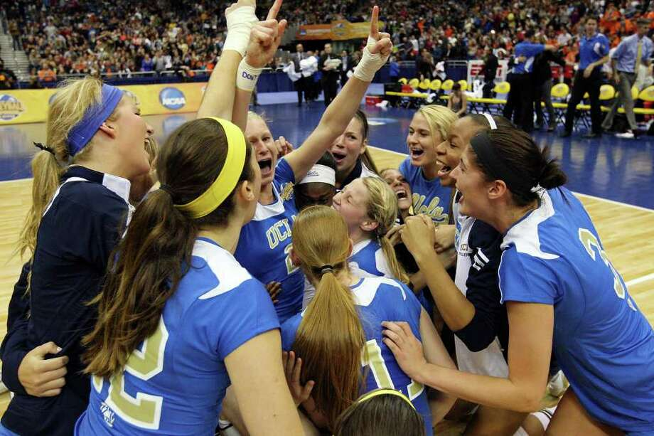 Members of the UCLA Bruins celebrate their 3-1 win over Illinois during the 2011 NCAA Division I Women's Volleyball National Championship match Saturday Dec. 17, 2011 at the Alamodome. PHOTO BY EDWARD A. ORNELAS/eaornelas@express-news.net) Photo: EDWARD A. ORNELAS, Express-News / © SAN ANTONIO EXPRESS-NEWS (NFS)