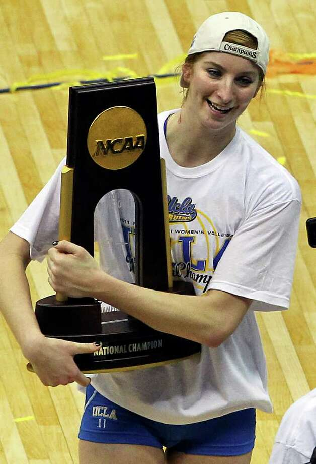 Rachael Kidder cradles the trophy as UCLA beats  Illinois in the  2011 NCAA National Championship volleyball match at the Alamodome on December 17, 2011 Tom Reel/Staff Photo: TOM REEL, Express-News / © 2011 San Antonio Express-News