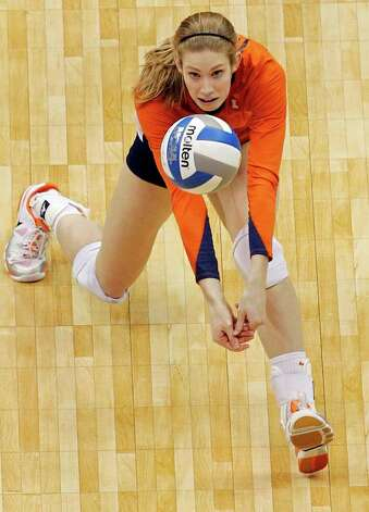 Illinois' Anna Dorn goes for a dig against UCLA during game action of the 2011 NCAA Division I Women's Volleyball National Championship Match at the Alamodome on Saturday, Dec. 17, 2011. UCLA won in four sets, 25-23, 23-25, 26-24, 25-16. MICHAEL MILLER / mmiller@express-news.net Photo: MICHAEL MILLER, Express-News / mmiller@express-news.net