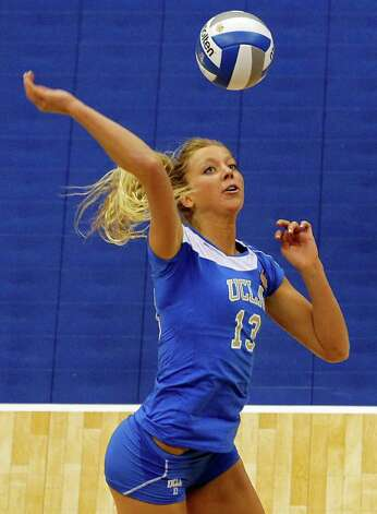 UCLA's Zoe Nightingale goes for a kill against Illinois during game action of the 2011 NCAA Division I Women's Volleyball National Championship Match at the Alamodome on Saturday, Dec. 17, 2011. UCLA won in four sets, 25-23, 23-25, 26-24, 25-16. MICHAEL MILLER / mmiller@express-news.net Photo: MICHAEL MILLER, Express-News / mmiller@express-news.net