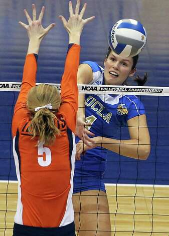 The Bruins' Sara Sage blasts the ball through Laura Van Orden as UCLA plays Illinois in the  2011 NCAA National Championship volleyball match at the Alamodome on December 17, 2011 Tom Reel/Staff Photo: TOM REEL, Express-News / © 2011 San Antonio Express-News