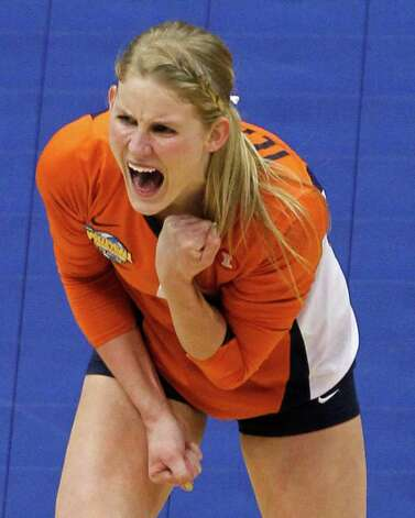 Illinois' Colleen Ward celebrates after winning a point against UCLAduring game action of the 2011 NCAA Division I Women's Volleyball National Championship Match at the Alamodome on Saturday, Dec. 17, 2011. UCLA won in four sets, 25-23, 23-25, 26-24, 25-16. MICHAEL MILLER / mmiller@express-news.net Photo: MICHAEL MILLER, Express-News / mmiller@express-news.net