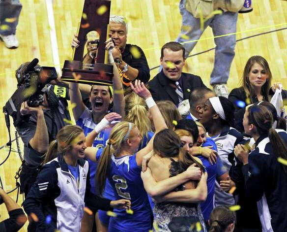 The Bruins raise their trophy as UCLA beats Illinois in the  2011 NCAA National Championship volleyball match at the Alamodome on December 17, 2011 Tom Reel/Staff Photo: TOM REEL, Express-News / © 2011 San Antonio Express-News