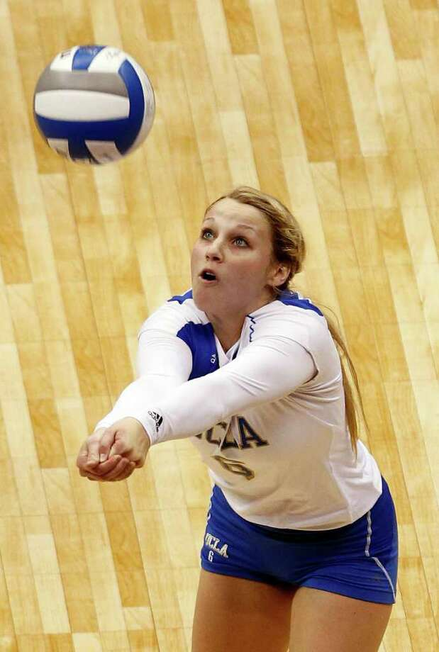 UCLA's Lainey Gera bumps the ball against Illinois during game action of the 2011 NCAA Division I Women's Volleyball National Championship Match at the Alamodome on Saturday, Dec. 17, 2011. UCLA won in four sets, 25-23, 23-25, 26-24, 25-16. MICHAEL MILLER / mmiller@express-news.net Photo: MICHAEL MILLER, Express-News / mmiller@express-news.net