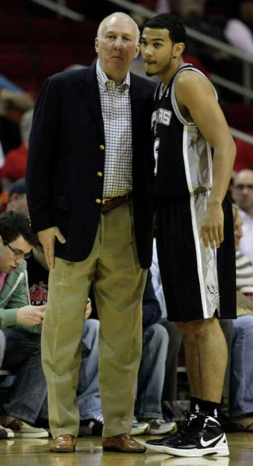 Spurs coach Gregg Popovich talks to rookie guard Cory Joseph during Saturday's preseason opener. Photo: Brett Coomer, Houston Chronicle / © 2011 Houston Chronicle