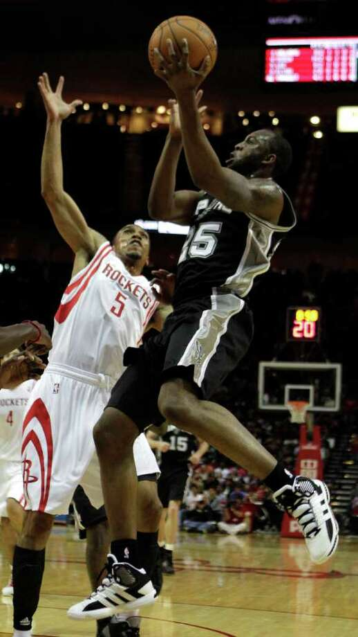 San Antonio Spurs shooting guard James Anderson (25) drives to the basket against Houston Rockets shooting guard Courtney Lee (5) during the first half of a pre-season NBA basketball game at Toyota Center Saturday, Dec. 17, 2011, in Houston. The Rockets beat the Spurs 101-87. Photo: Brett Coomer, Houston Chronicle / © 2011 Houston Chronicle