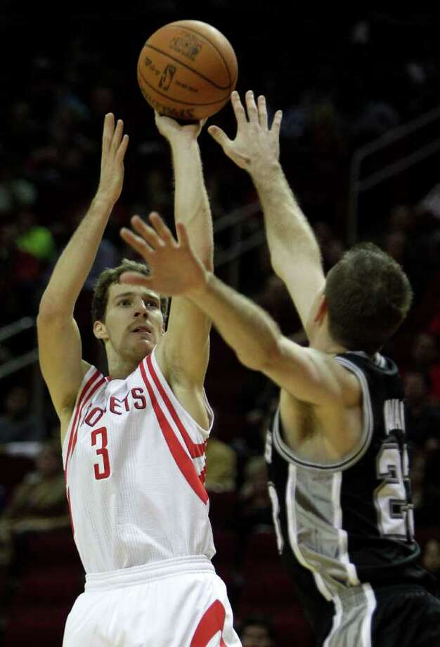Houston Rockets point guard Goran Dragic (3) shoots over San Antonio Spurs forward Steve Novak (23) during the second half of a pre-season NBA basketball game at Toyota Center Saturday, Dec. 17, 2011, in Houston. The Rockets beat the Spurs 101-87. Photo: Brett Coomer, Houston Chronicle / © 2011 Houston Chronicle