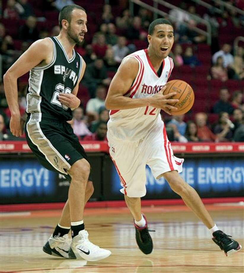 Houston Rockets' Kevin Martin, right, drives around San Antonio Spurs' Manu Ginobili, left, of Argentina, during the first quarter of a preseason NBA basketball game, Saturday, Dec. 17, 2011, in Houston. (AP Photo/Dave Einsel) Photo: Associated Press