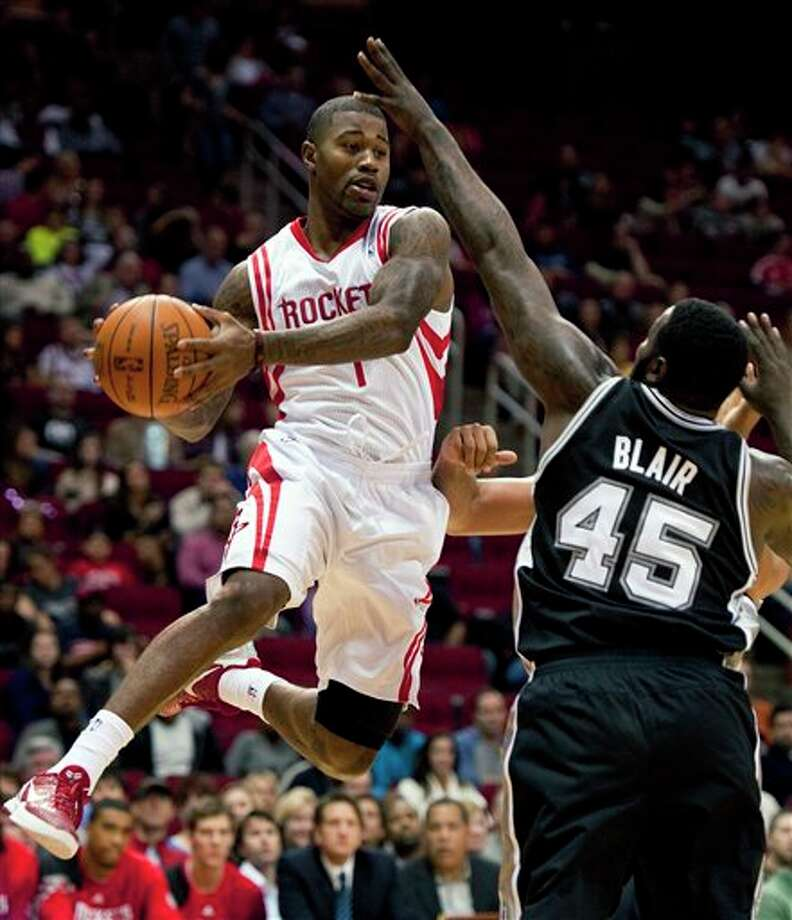 Houston Rockets' Terrence Williams (1) drives against San Antonio Spurs' DeJuan Blair (45) during the first quarter of a preseason NBA basketball game, Saturday, Dec. 17, 2011, in Houston. (AP Photo/Dave Einsel) Photo: Associated Press