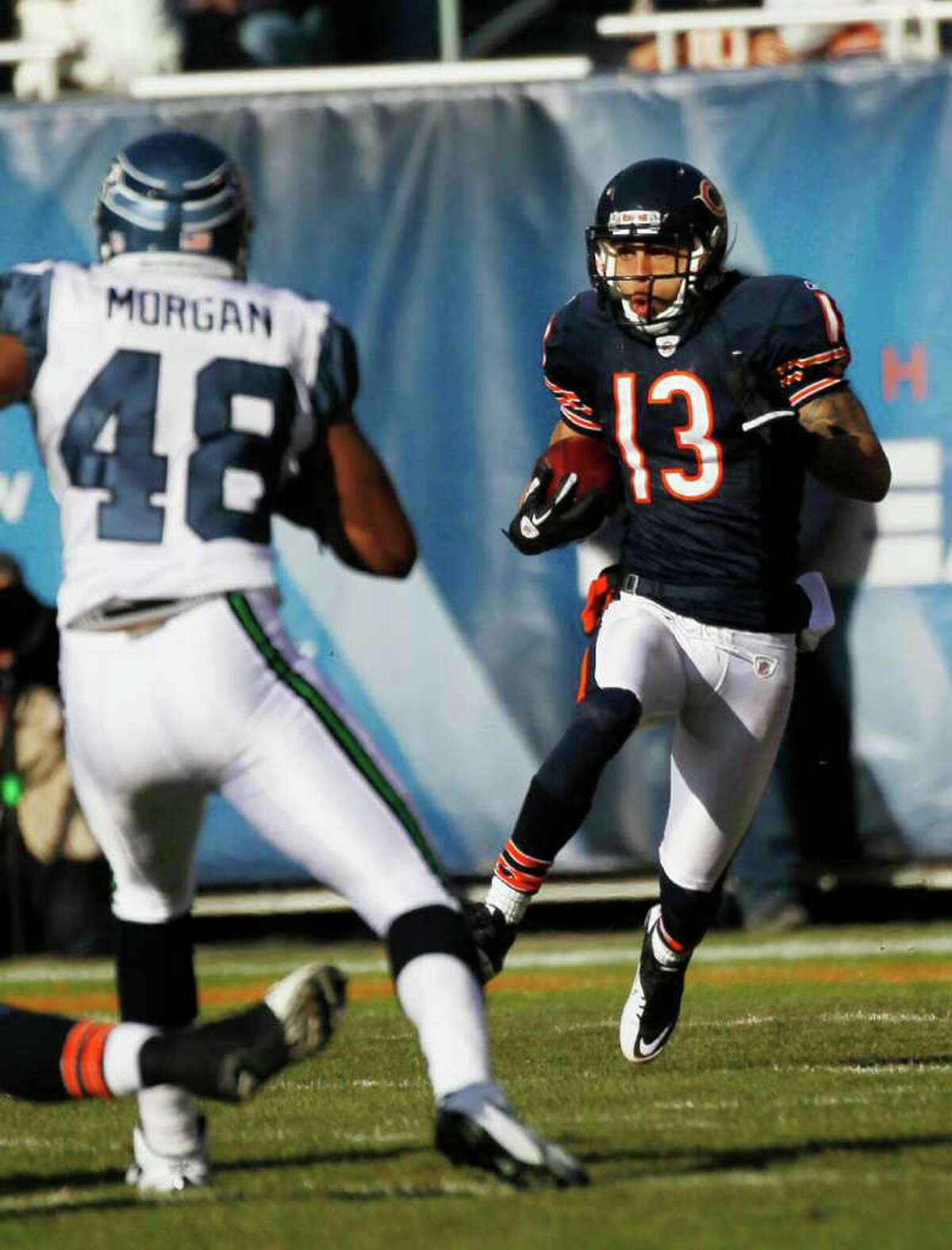 1Chicago Bears' Johnny Knox (13) returns the opening kickoff as Seattle Seahawks' Mike Morgan (48) closes in during the first half of an NFL football game in Chicago, Sunday, Dec. 18, 2011.