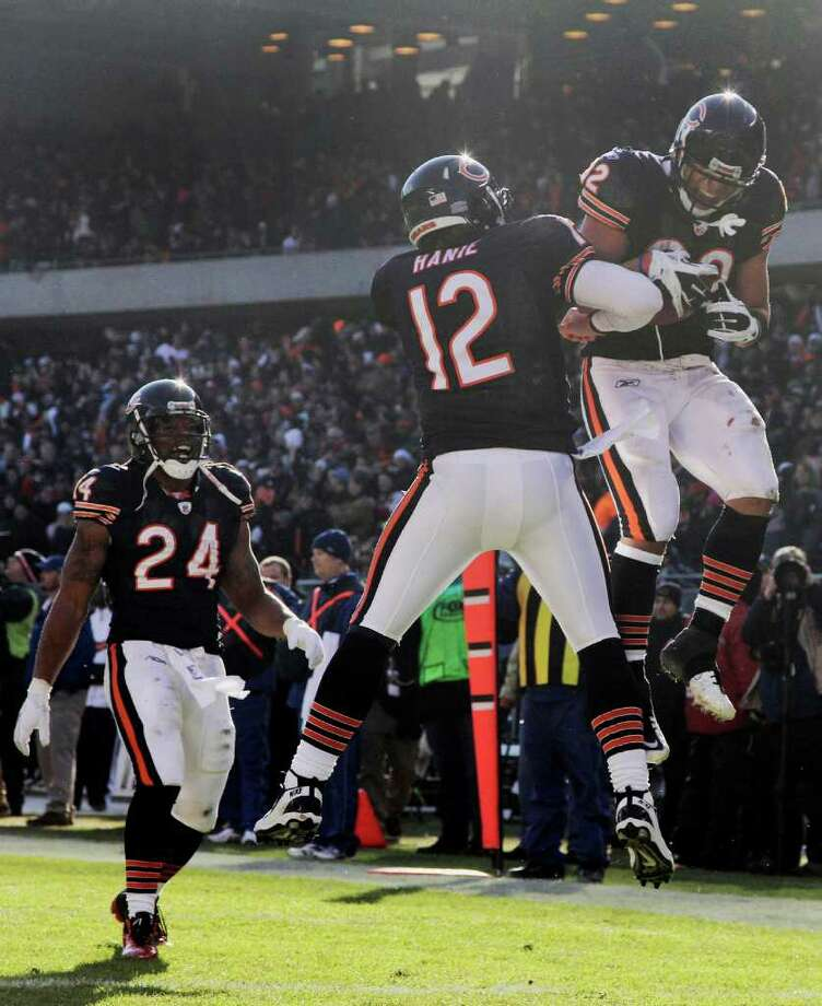 Chicago Bears running back Kahlil Bell (32) celebrates with quarterback Caleb Hanie (12) after he caught a 25-yard pass for a touchdown in the first half of an NFL football game against the Seattle Seahawks in Chicago, Sunday, Dec. 18, 2011. Looking on is running back Marion Barber (24). Photo: AP