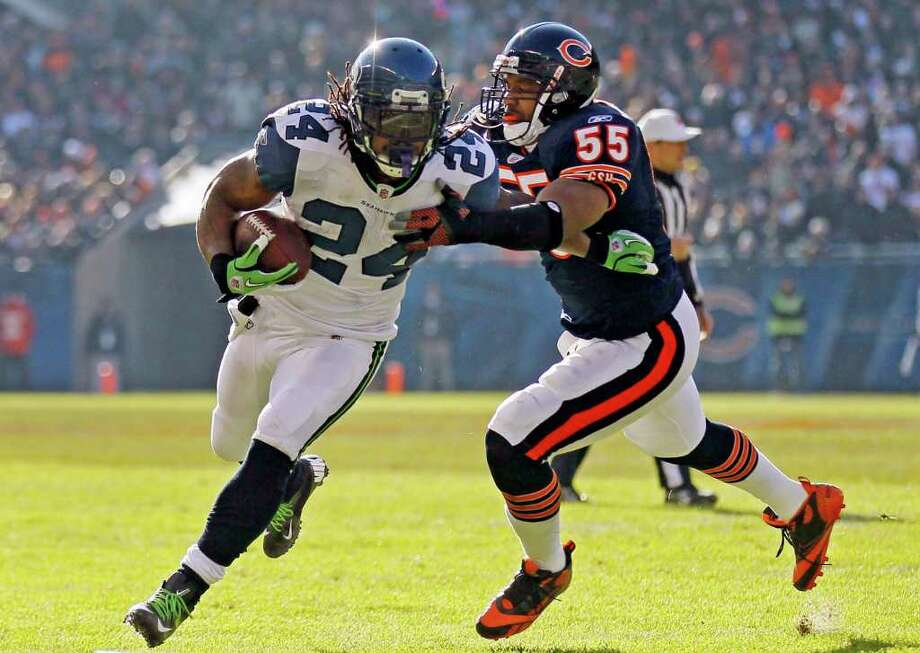 Seattle Seahawks running back Marshawn Lynch (24) is tackled by Chicago Bears linebacker Lance Briggs (55) in the first half of an NFL football game in Chicago, Sunday, Dec. 18, 2011. Photo: AP