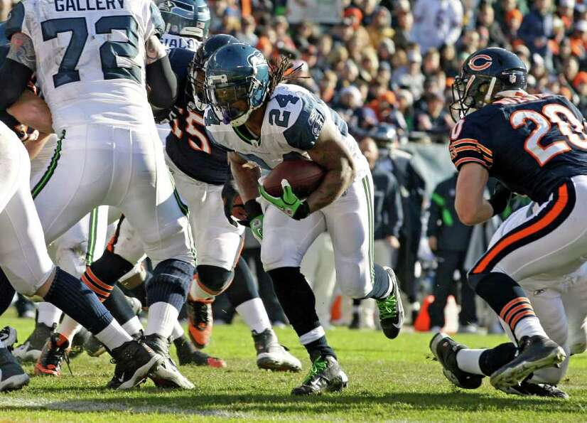 Seattle Seahawks running back Marshawn Lynch (24) scores on a 2-yard run past Chicago Bears safety C