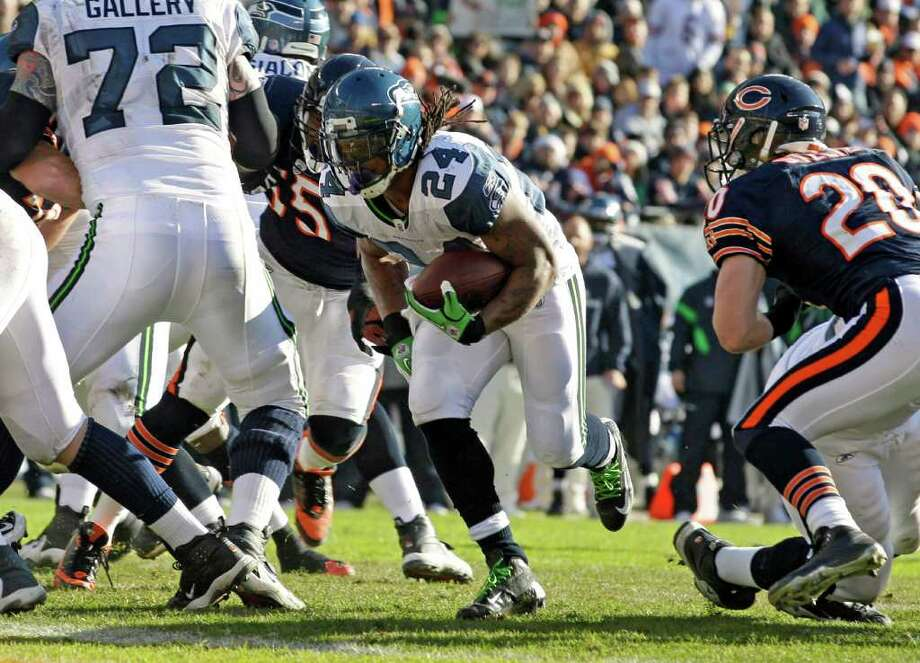 Seattle Seahawks running back Marshawn Lynch (24) scores on a 2-yard run past Chicago Bears safety Craig Steltz (20) in the first half of an NFL football game against the Chicago Bears in Chicago, Sunday, Dec. 18, 2011. Photo: AP