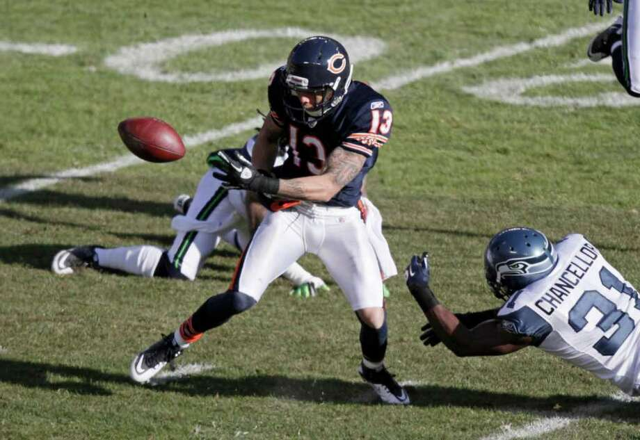 Chicago Bears wide receiver Johnny Knox (13) has the ball stripped from his hands by Seattle Seahawks safety Kam Chancellor (31) after a pass reception in the first half of an NFL football game in Chicago, Sunday, Dec. 18, 2011. Knox was injured on the play while going for the loose ball. Photo: AP
