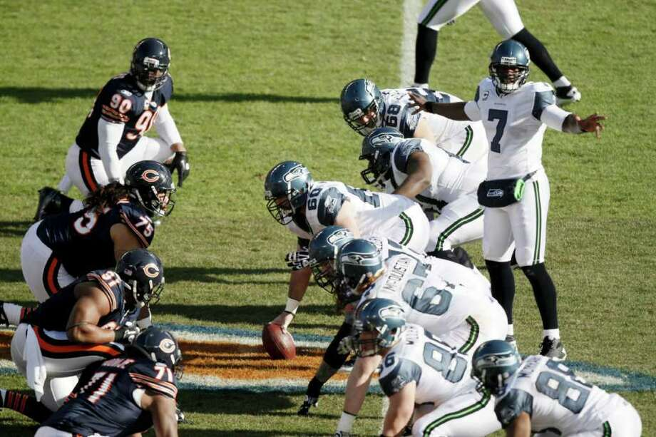 Seattle Seahawks quarterback Tarvaris Jackson (7) calls a play from the line of scrimmage in the first half of an NFL football game against the Chicago Bears in Chicago, Sunday, Dec. 18, 2011. Photo: AP