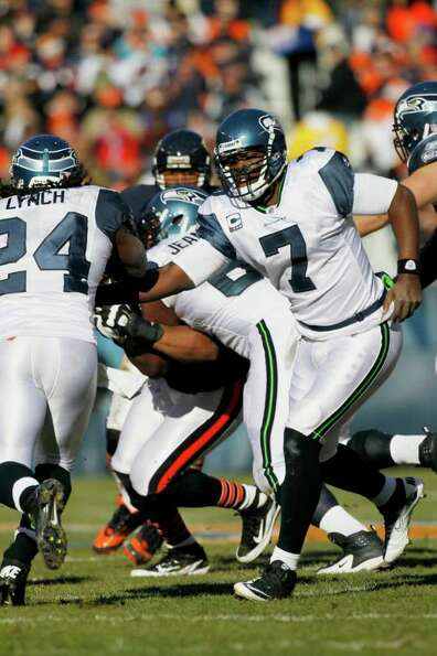 Seattle Seahawks quarterback Tarvaris Jackson (7) hands off to  running back Marshawn Lynch (24) in