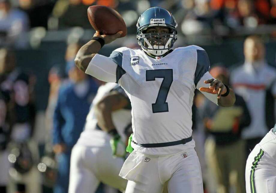 Seattle Seahawks quarterback Tarvaris Jackson (7) passes against the Chicago Bears in the first half of an NFL football game in Chicago, Sunday, Dec. 18, 2011. Photo: AP