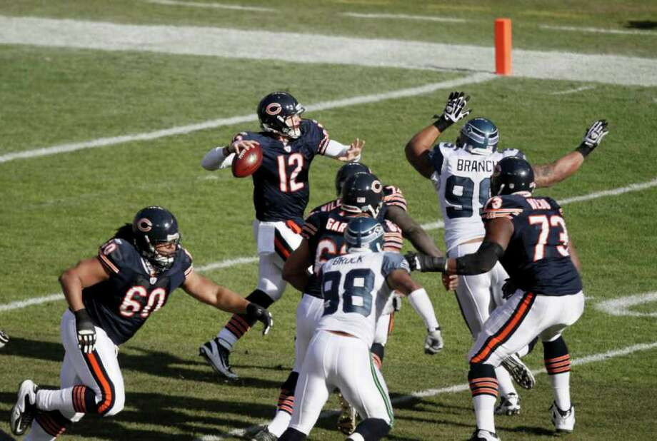 Chicago Bears quarterback Caleb Hanie (12) passes in the first half of an NFL football game against the Seattle Seahawks in Chicago, Sunday, Dec. 18, 2011. Photo: AP