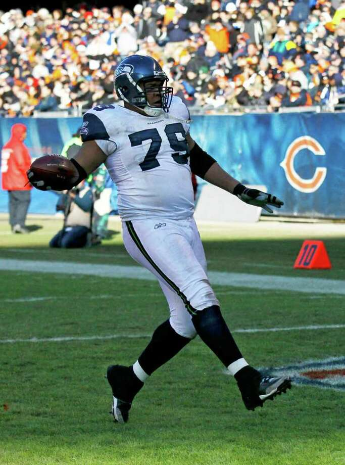 Seattle Seahawks defensive end Red Bryant (79) scores on a 20-yard interception return in the second half of an NFL football game against the Chicago Bears in Chicago, Sunday, Dec. 18, 2011. Photo: AP