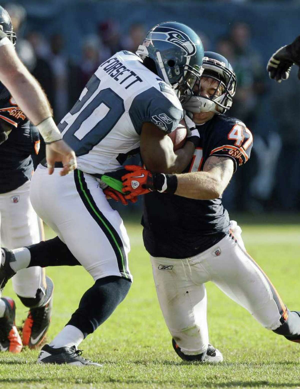 Seattle Seahawks running back Justin Forsett (20) is tackled by Chicago Bears safety Chris Conte (47) in the first half of an NFL football game in Chicago, Sunday, Dec. 18, 2011.