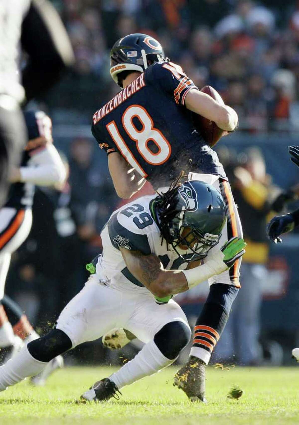 Seattle Seahawks safety Earl Thomas (29) tackles Chicago Bears wide receiver Dane Sanzenbacher (18) in the first half of an NFL football game in Chicago, Sunday, Dec. 18, 2011.