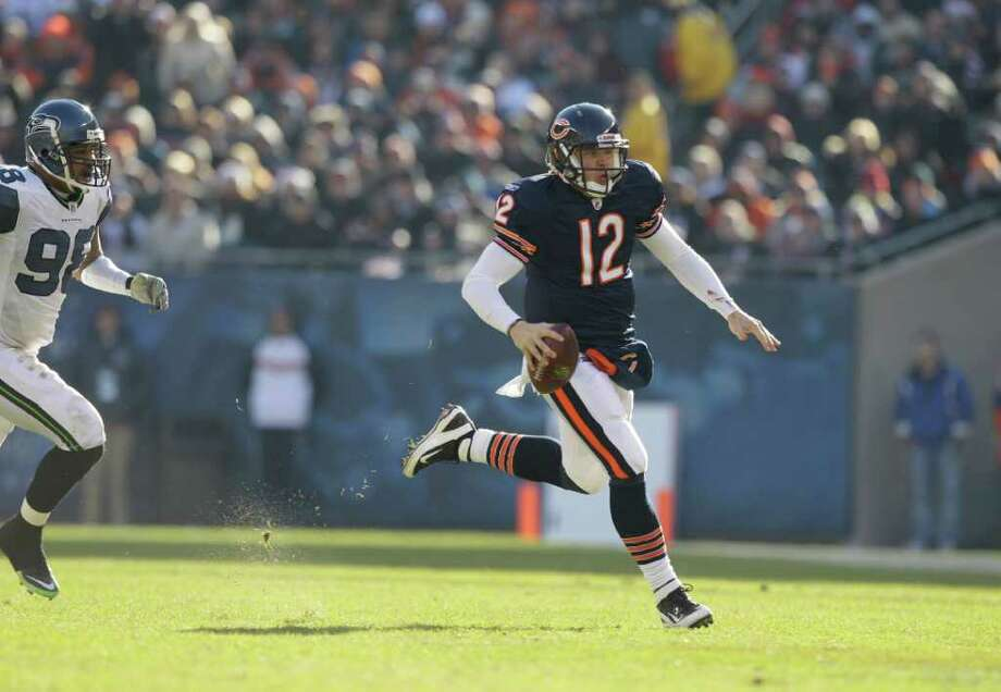 Chicago Bears quarterback Caleb Hanie (12) scrambles in the first half of an NFL football game against the Seattle Seahawks in Chicago, Sunday, Dec. 18, 2011. Photo: AP