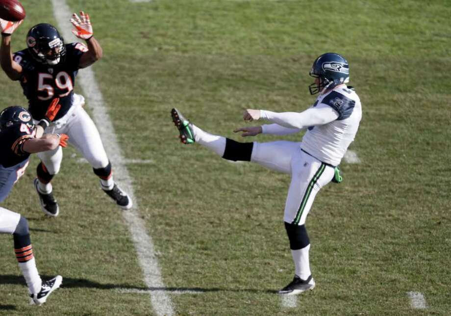 Seattle Seahawks punter Jon Ryan (9) punts against the Chicago Bears in the first half of an NFL football game in Chicago, Sunday, Dec. 18, 2011. Photo: AP