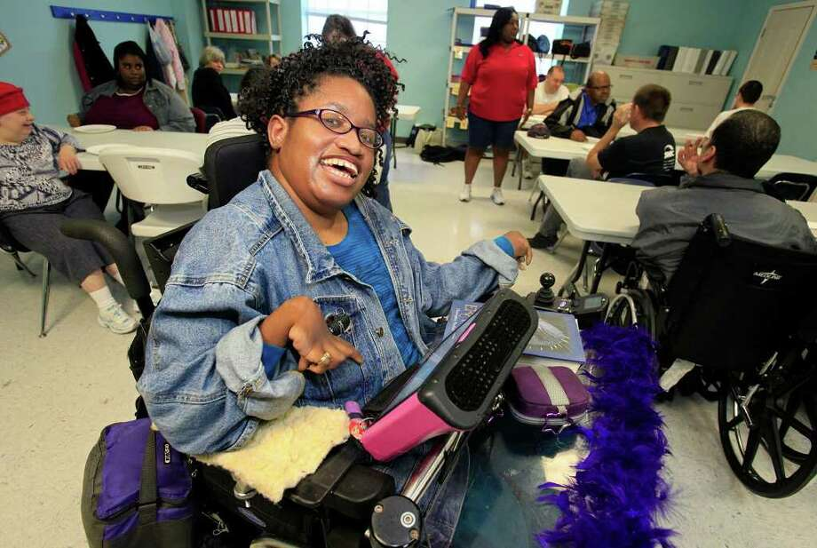 Tameka Hughes, 28, is confined to a wheel chair with cerebral palsy but utilizing technology she communicates and produces the ARC Times newsletter, creates flyers for various clubs and is the official blogger of the ARC website. We see Tameka in one of the ARC classrooms, Tuesday, December 13, 2011. Photo: J. MICHAEL SHORT, SPECIAL TO THE EXPRESS-NEWS / THE SAN ANTONIO EXPRESS-NEWS