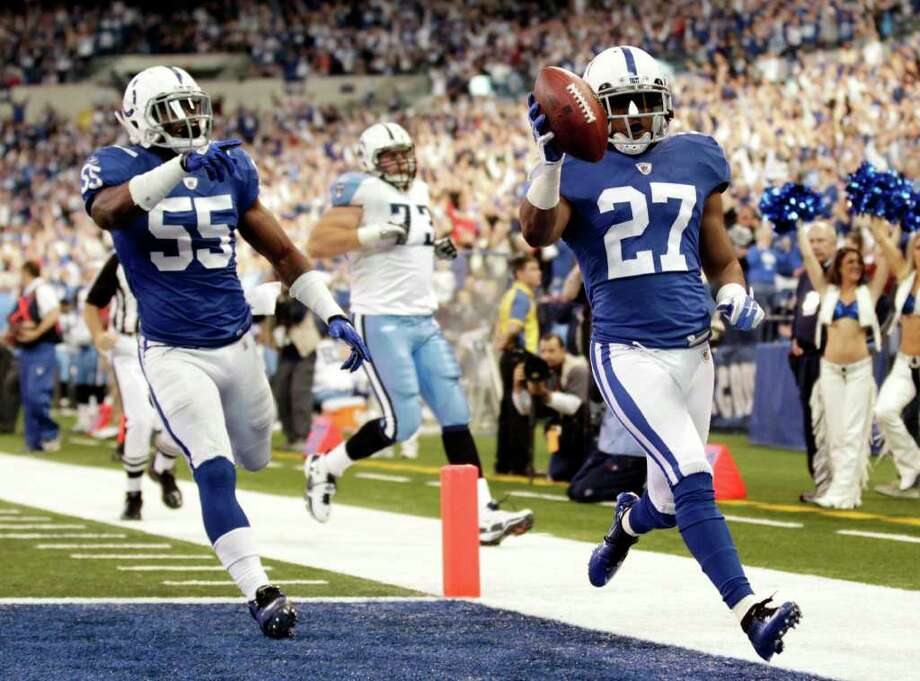 Colts cornerback Jacob Lacey (27) scores on an interception return against the Titans as Ernie Sims celebrates. Photo: AP