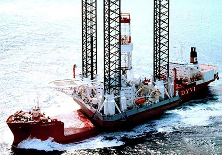 """In this undated handout photo released by Arktikmorneftegazrazvedka an oil drilling platform """"Kolskaya"""" is seen in the Sea of Okhotsk. The oil drilling platform has capsized in the Sea of Okhotsk off Russia's east coast, leaving four people reportedly dead and 49 missing. The Emergencies Ministry said in a statement Sunday that there were 67 people aboard the platform as it was being towed about 200 kilometers (120 miles) off the coast of Sakhalin Island in stormy conditions. It said 14 people had been rescued. (AP Photo/Arktikmorneftegazrazvedka, HO)  NO SALES EDITORIAL USE ONLY Photo: HO / Arktikmorneftegazrazvedka"""