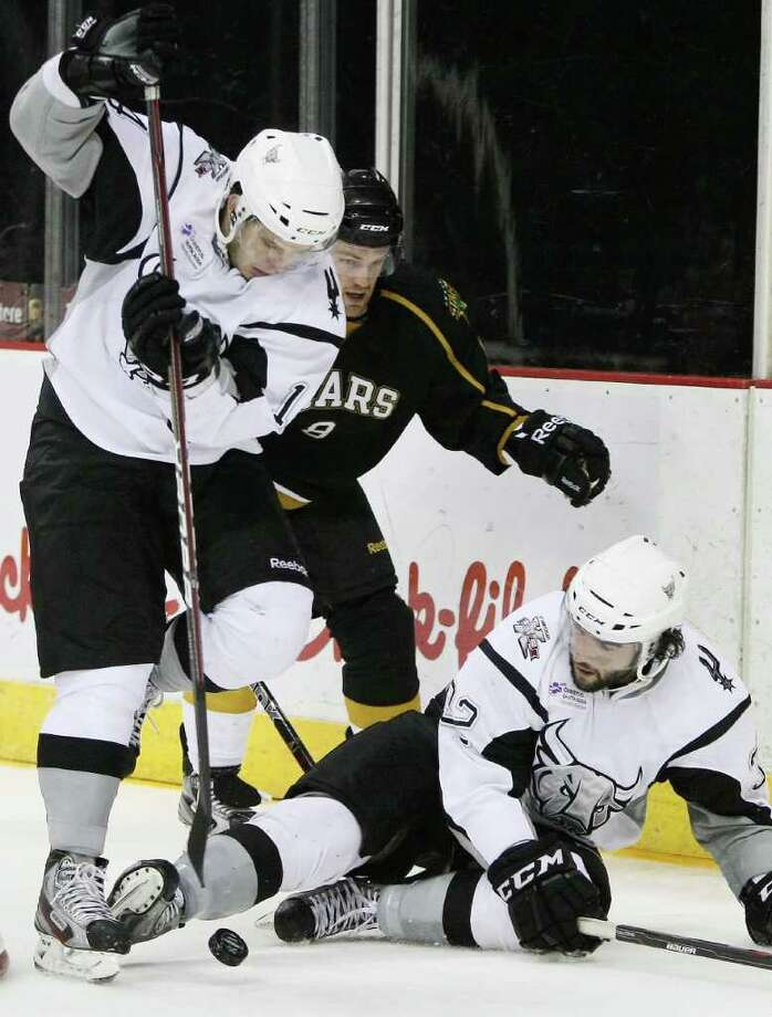 The Rampage's Scott Timmins (lower right) kicks the puck to Evgenii Dadonov (left) as Texas' Jordie Benn closes in. Photo: Darren Abate, Darren Abate/pressphotointl.com / Darren Abate/pressphotointl.com