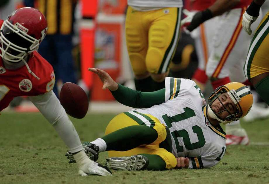 CHARLIE RIEDEL: ASSOCIATED PRESS HALI TO THE CHIEF: Green Bay Packers quarterback Aaron Rodgers (12) hits the turf after being sacked by Kansas City's Tamba Hali (91) in the second half of Kansas City's win Sunday at Arrowhead Stadium. Hali sacked Rodgers three times. Photo: Charlie Riedel / AP