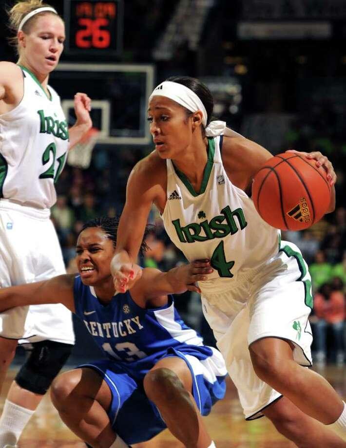 Notre Dame guard Skylar Diggins drives the lane against Kentucky's Bria Goss. Photo: AP