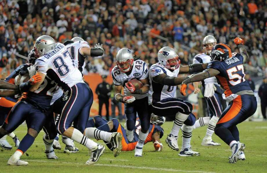 Patriots running back BenJarvus Green-Ellis (42) cuts through the Broncos defense on a fourth-quarter TD run. Photo: AP