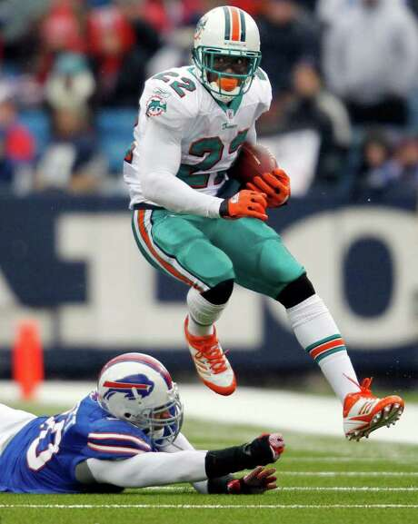 Dolphins running back Reggie Bush eludes a tackler during his 203-yard day against Buffalo. Photo: AP