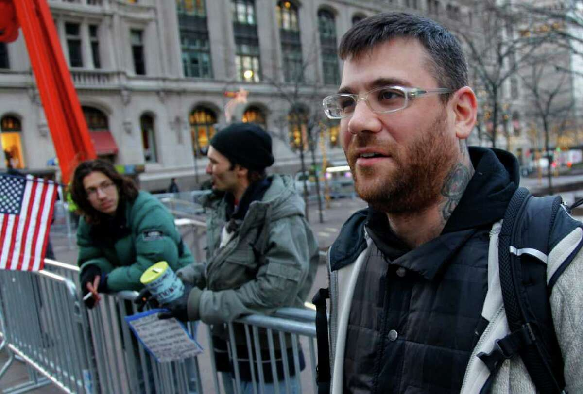 """BEBETO MATTHEWS : ASSOCIATED PRESS DIY ETHIC: Pete Dutro, 36, is part of both Generation X and Occupy Wall Street. """"Twenty-somethings really are the catalyst, buyt my generation paved the way for them to do this."""""""