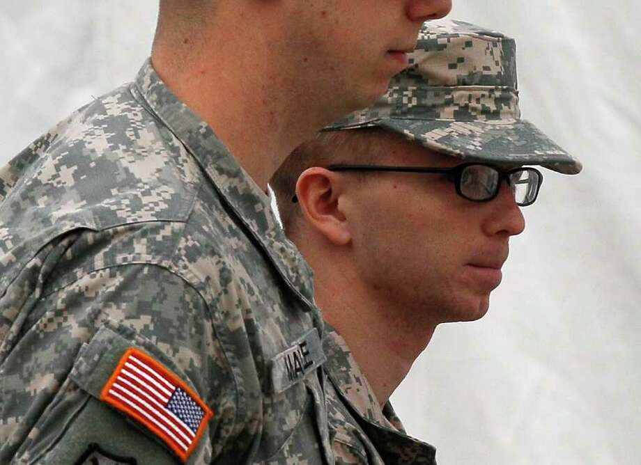 PATRICK SEMANSKY : AP CALM: Army Pfc. Bradley Manning, right, faces a life sentence if convicted. Photo: Patrick Semansky / AP