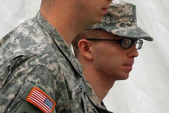 PATRICK SEMANSKY : AP CALM: Army Pfc. Bradley Manning, right, faces a life sentence if convicted.