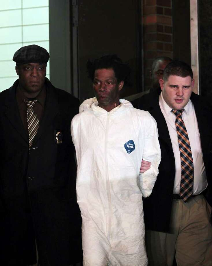 Jerome Isaac (center) was arrested in the death of a woman set afire in an elevator. Isaac told police he set Deloris Gillespie, 73, on fire because she owed him $2,000. Photo: Robert Mecea, Associated Press