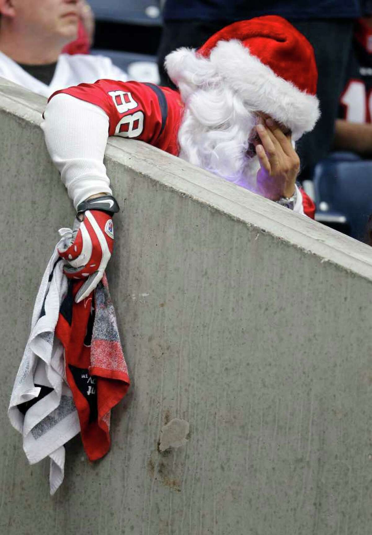 Houston Texans fan Ruben Rincon reacts after the Texans interception during the fourth quarter of the NFL football game at Reliant Stadium, Dec. 18, 2011, in Houston. Panthers won 28-13.
