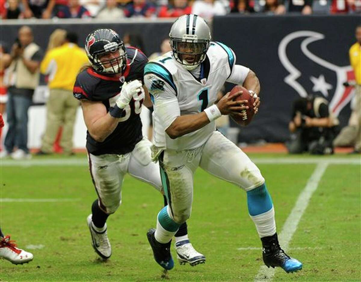 Carolina Panthers quarterback Cam Newton (1) evades Houston Texans outside linebacker Brooks Reed (58) during the third quarter of an NFL football game Sunday, Dec. 18, 2011, in Houston. (AP Photo/Dave Einsel)