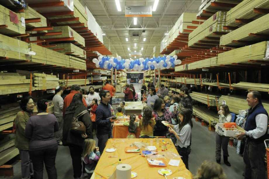 Families And Home Depot Employees Visit With Each Other In The Lumber Section At