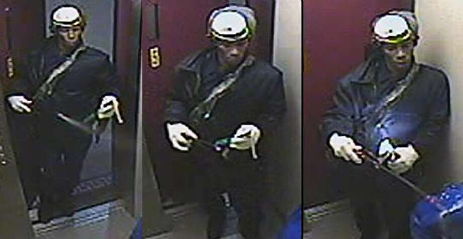 This Saturday, Dec. 17, 2011 surveillance photo provided by the New York (City) Police Dept. shows a suspect wanted in connection with a homicide, in the Brooklyn borough of New York. A woman burned to death in the elevator of her Brooklyn apartment building Saturday afternoon after a man ambushed her, sprayed her with liquid and set her afire with a Molotov cocktail, police said. (AP Photo/New York Police Dept.)