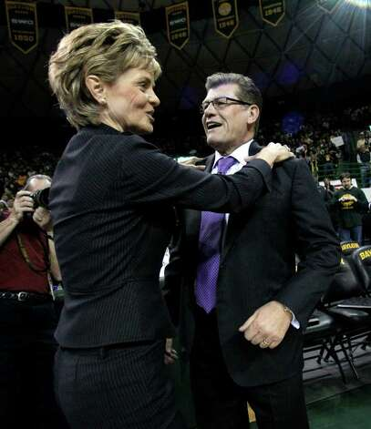 Baylor Bears head coach Kim Mulkey  and Connecticut head coach Geno Auriemma joke around as they greet each other before the start of their NCAA college basketball game Sunday, Dec. 18, 2011, in Waco, Texas. (AP Photo/Tony Gutierrez) Photo: Tony Gutierrez, Associated Press / AP