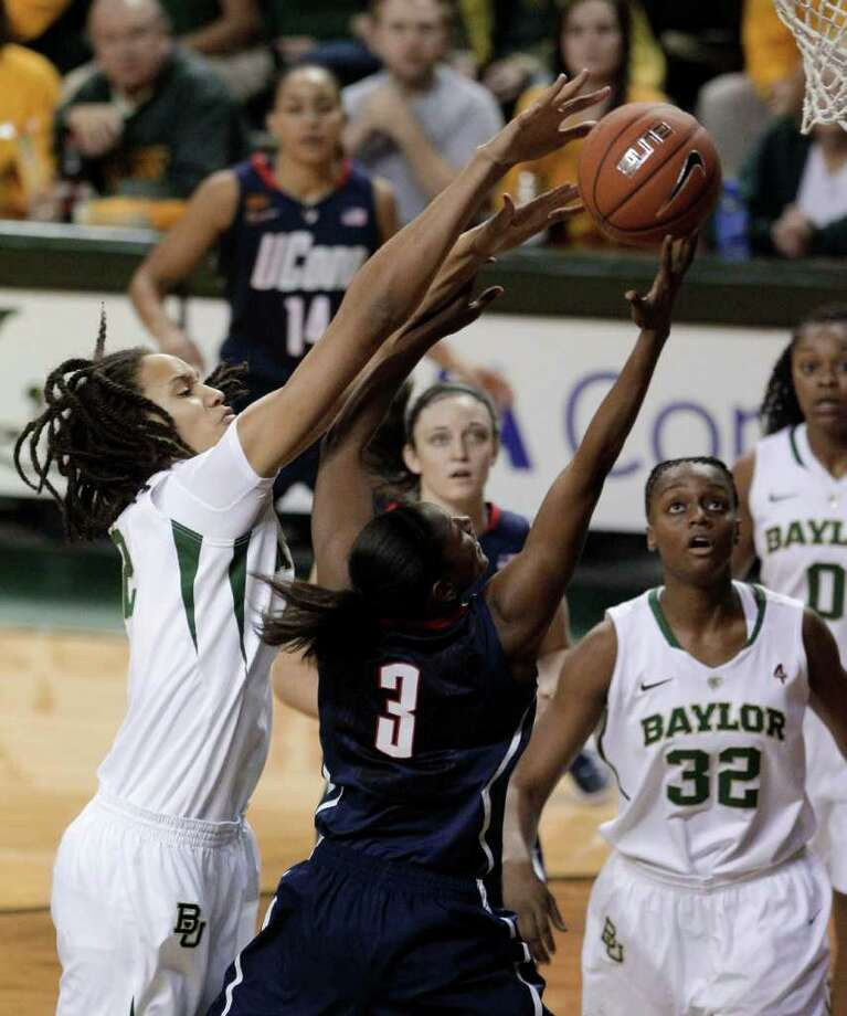 Baylor center Brittney Griner (left) blocks a shot attempt by Connecticut guard Tiffany Hayes. Griner finished with nine blocks and set a Big 12 career record. Photo: AP