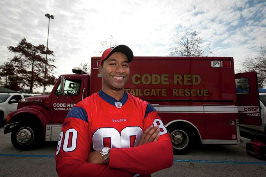 "NATHAN LINDSTROM: FOR THE CHRONICLE SWEET RIDE: Longtime Texans fan Dr. Pavan Pinnamaneni built his ""Fanbulance,"" with the help of his friends, out of an ambulance he purchased on eBay. Photo: Nathan Lindstrom / ©2011 Nathan Lindstrom"
