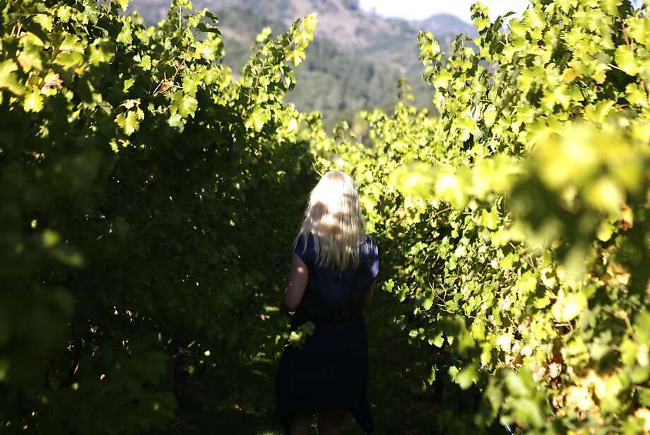 Rebekah Hudson of Georgia walks through the vineyard at Twomey Cellars in Calistoga, Calif., on Tuesday, Oct. 18, 2011. Photo: Dylan Entelis, The Chronicle