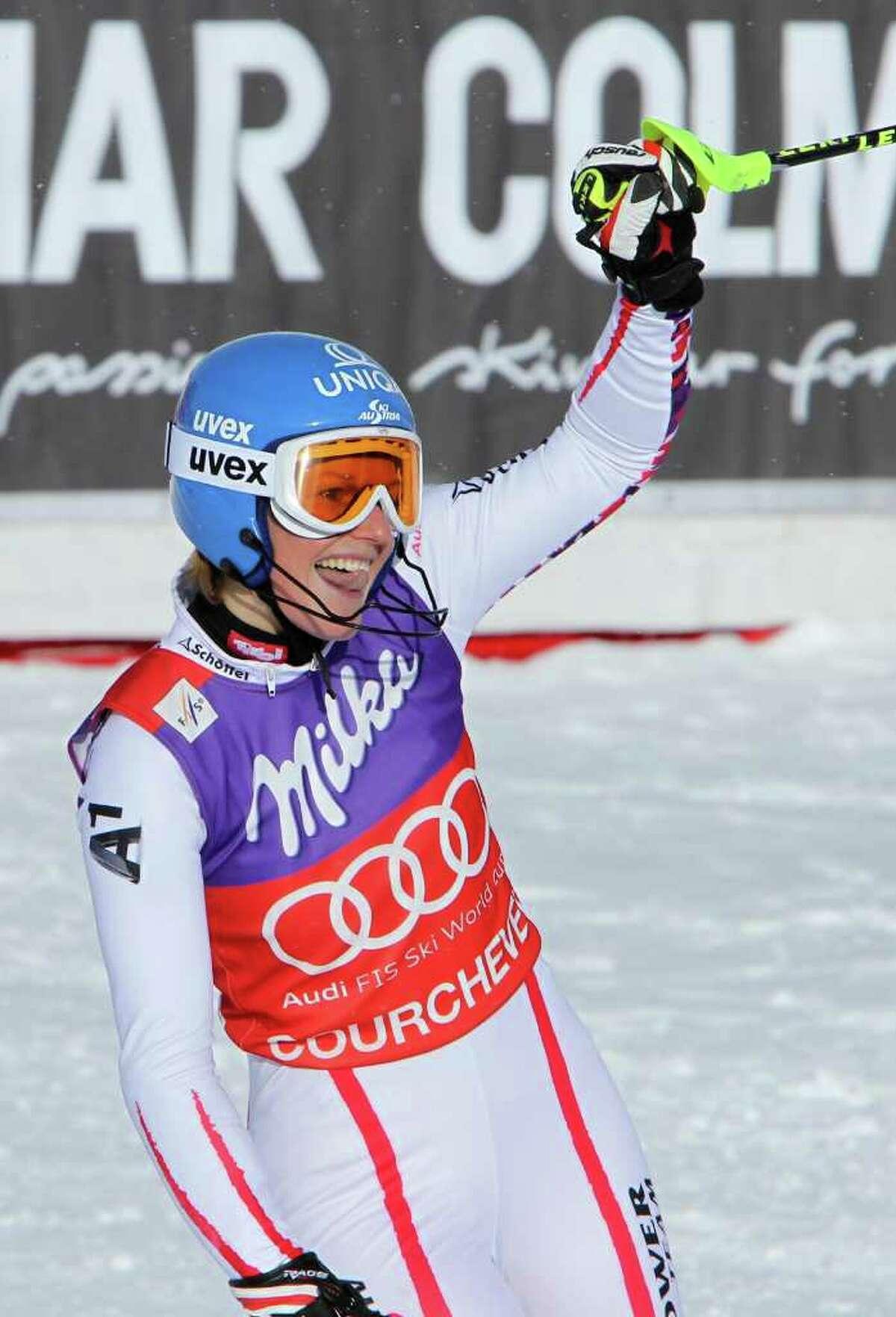 Austria's Marlies Schild celebrates after winning an alpine ski, women's World Cup slalom, in Courchevel, France, Sunday, Dec. 18, 2011. (AP Photo/Marco Trovati)