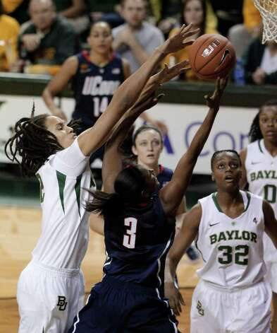 Baylor center Brittney Griner (42) blocks a shot attempt by Connecticut guard Tiffany Hayes (3) as Baylor's Brooklyn Pope (32) looks on in the first half of an NCAA college basketball game Sunday, Dec. 18, 2011, in Waco, Texas. (AP Photo/Tony Gutierrez) Photo: Tony Gutierrez, Associated Press / AP